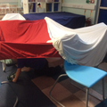 Indoor Forest School - den making.