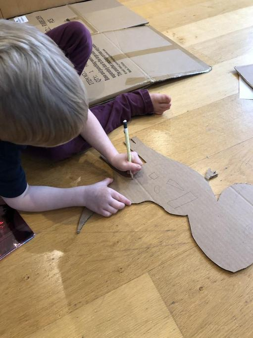 Cutting out the shapes... what will it be?