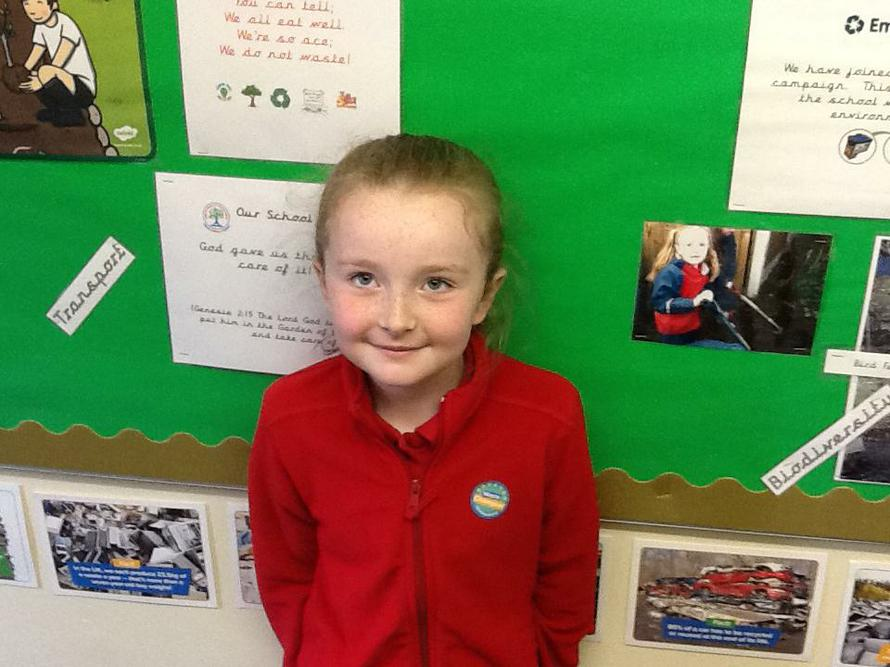Lily winning a sticker award