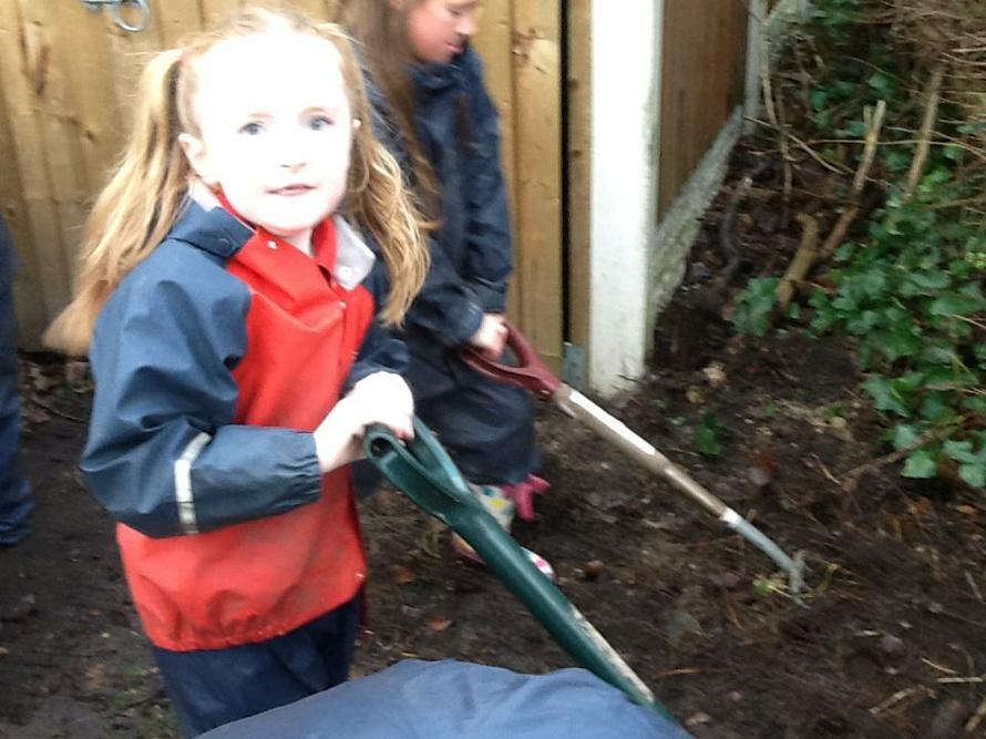 Lily enjoyed using the big spade.