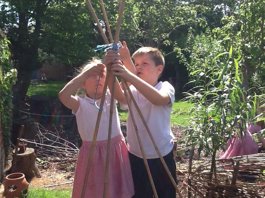 Alex and Destiny built a bamboo tee-pee