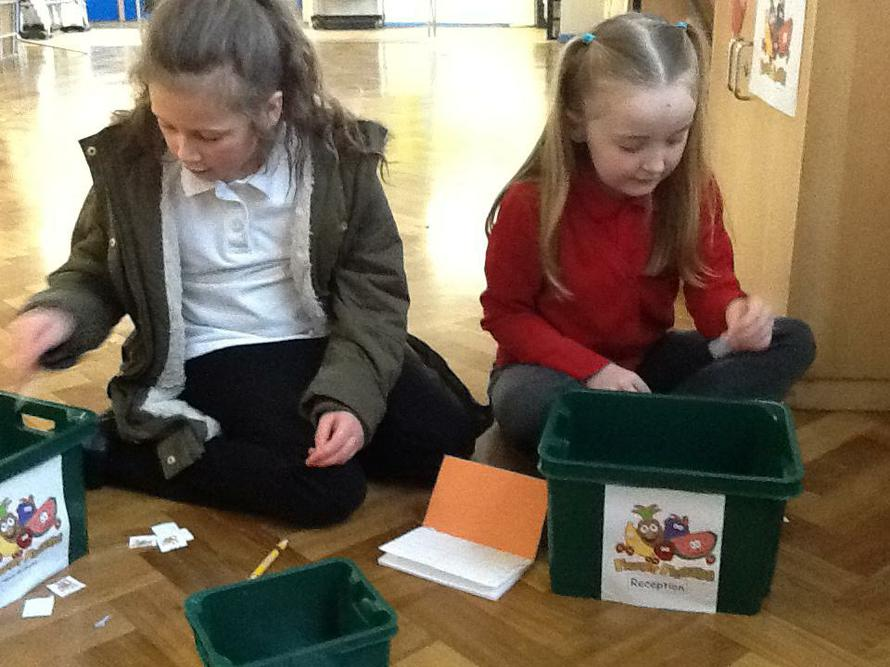 Amelia and Lily counting tokens.