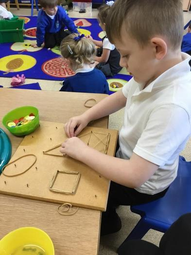 Using our fine motor skills to make shapes.