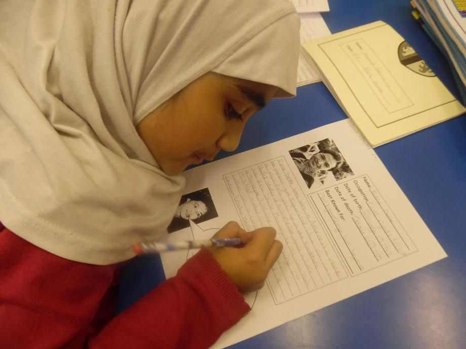 Year 4 writing a fact file about Rosa Park.