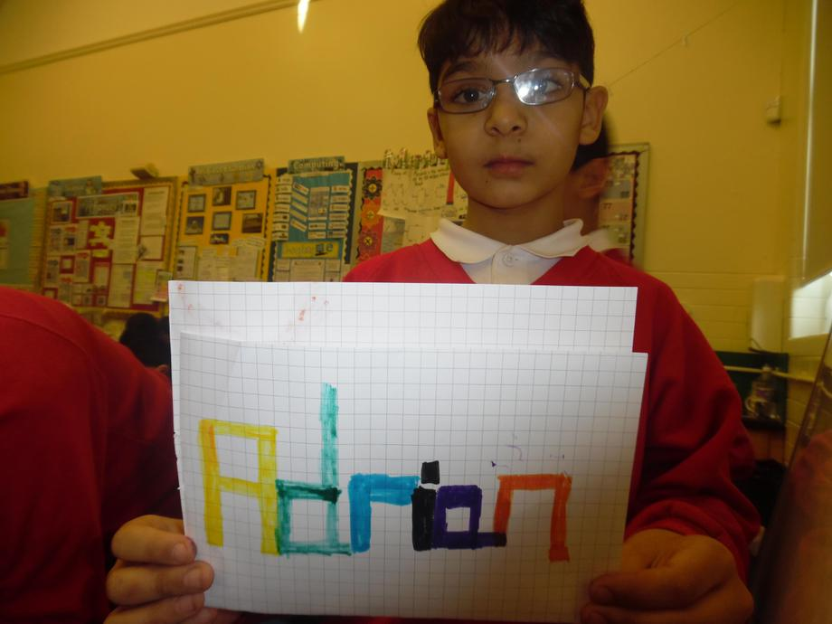 Designing our names on squared paper.