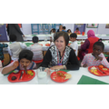 Ms Bailey enjoying her lunch with the children.