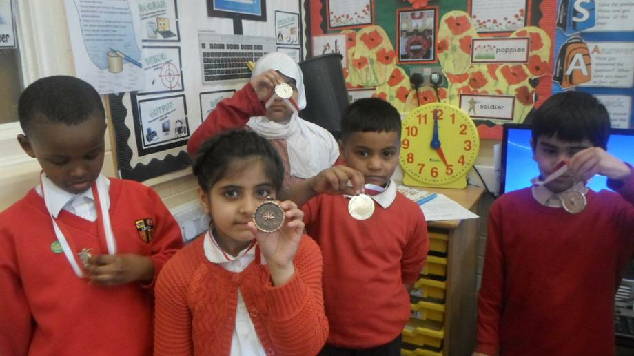 The children were very proud of their medals.