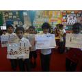 The children show off their work