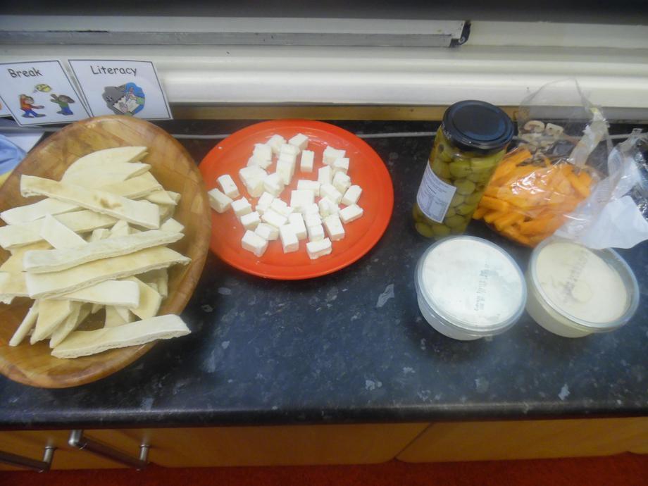 Pitta bread, feta cheese, humus, olives...