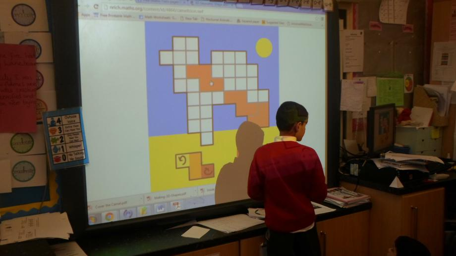 Covering grids using shapes