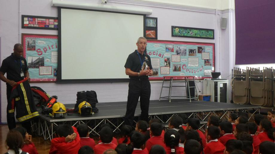 The fireman explains fire safety rules.
