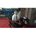 Usmaan gets to sit on the Vicar's chair