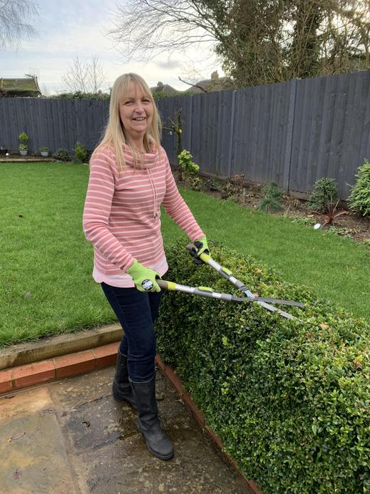 Mrs Reilly, a TA at Key Stage 2 and an SEN support, who enjoys a day in the garden