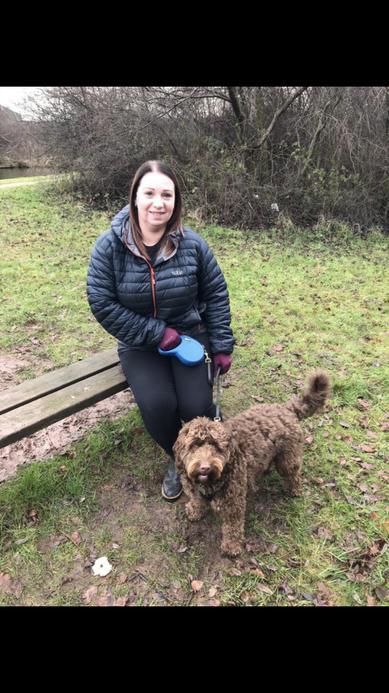 Mrs Lavender enjoys a walk with her dog
