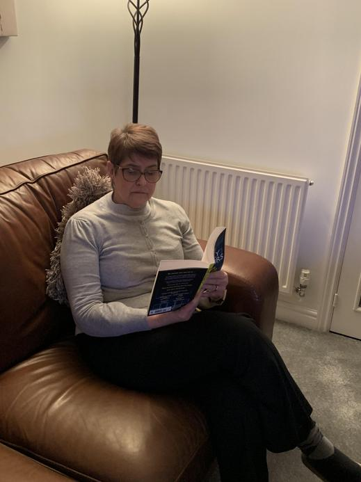 Mrs Hughes is our safeguarding lead and likes to have her head in a book