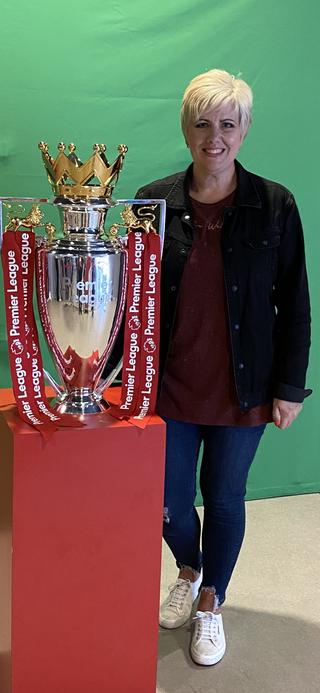 Mrs Brassington enjoys watching football
