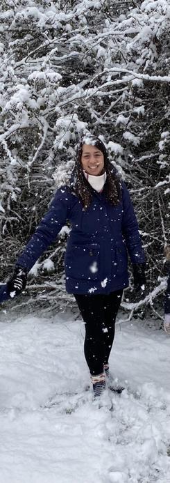 Mrs Davis a teacher in Year 1 who enjoys a walk in the snow.
