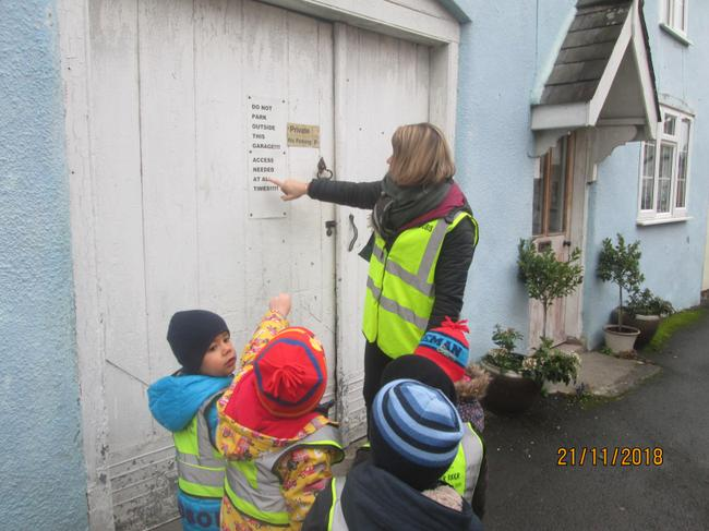 Noticing letters and numbers around the village.