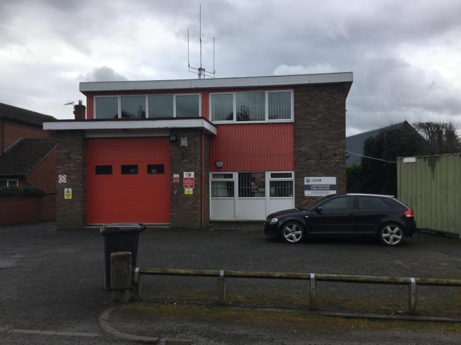 Firefighters use walkie-talkies to communicate.