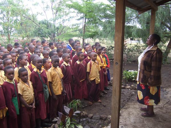 Mrs Mringo talking to the pupils