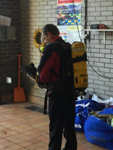 Fire fighters use breathing apparatus