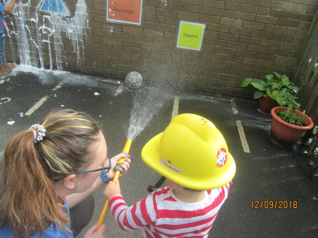 We sprayed the water using the hose.