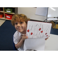 We used charcoal and red felt tip pens.