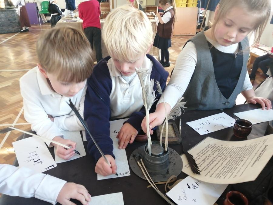 Using an ink and quill to write letters to the king.