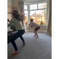 Megan doing a workout with her brother