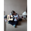 Eve practising her guitar skills.