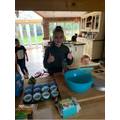 Amelia baking cupcakes