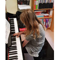 Lizzy showing off her piano skils