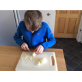 Tom putting his cooking club skills to the test