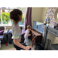 Milly doing a home workout with her brother