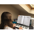 Heather learning the piano