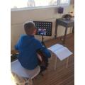 Tom having his guitar lesson via Skype