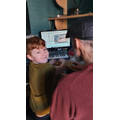 Jacob in his home music studio with Dad