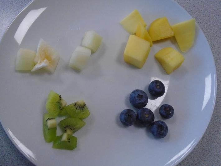 Kiwi, pineapple, melon, grapes and blueberries