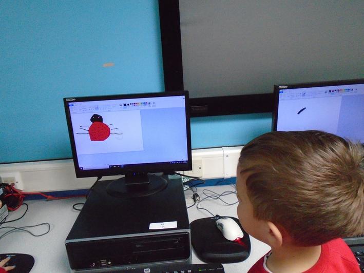 Using ICT program to draw a ladybird.