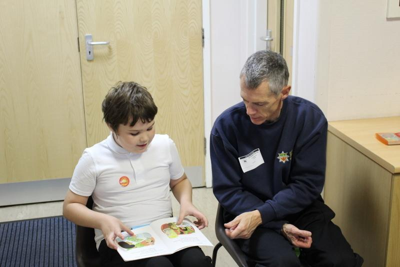 Firefighters come every week to help reading