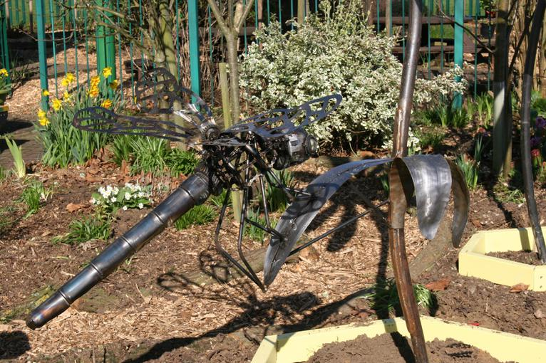 A dragonfly made from recycled car parts