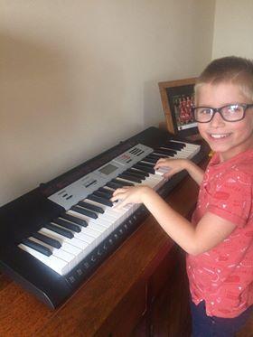 Matthew practising his keyboard skills