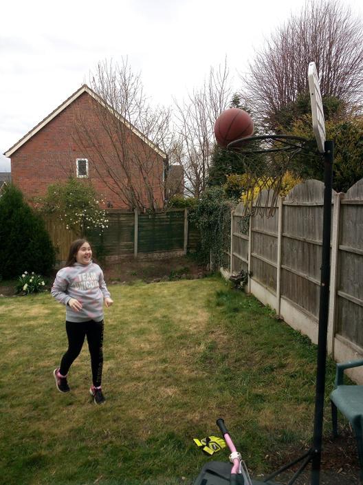 Shannon practising her basketball skills