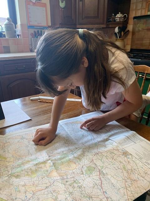 Emily working on her geography mapping skills