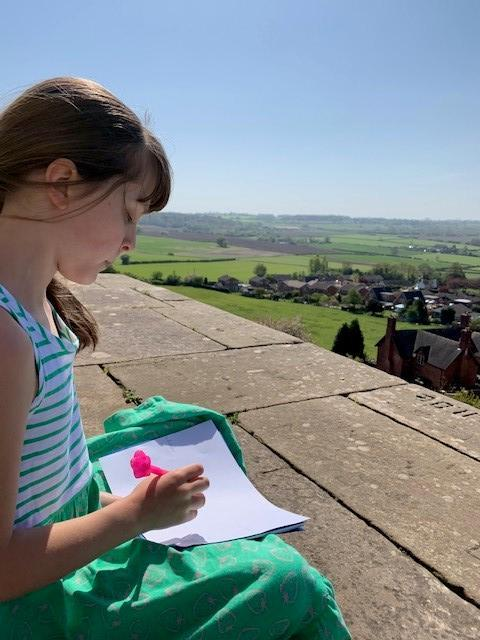 Emily creating a map from the monument
