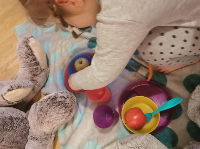 Lena K setting up her teddy bear's picnic.