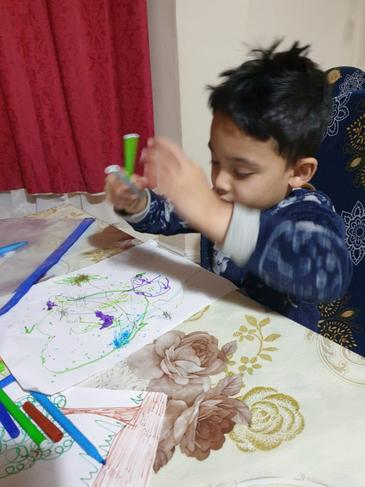 Yusuf creating his Rainforest picture.