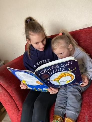 Things that make us happy - sharing a story with big sis!