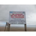 Beware of cars on the beach.