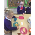 We use numerals to find out how many pieces of snack we can take from the serving plate.